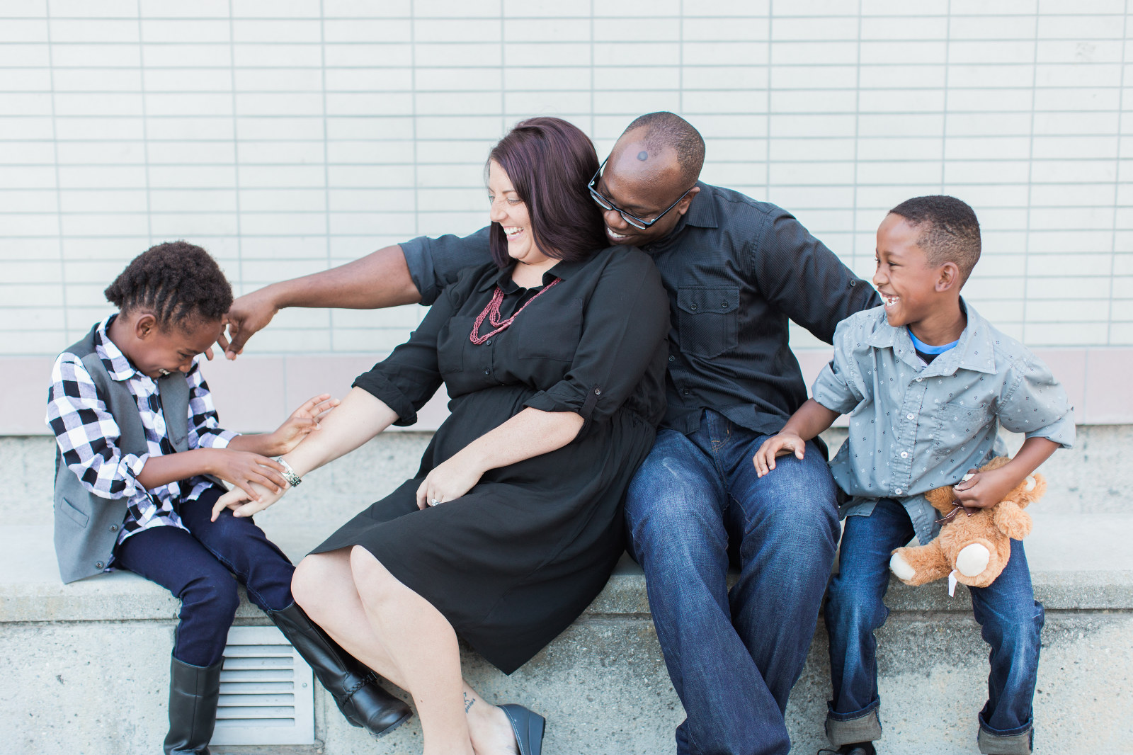 couple jokes with adopted children - charitable adoption photography